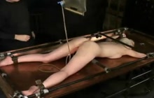Tied Blonde Gets An Enema