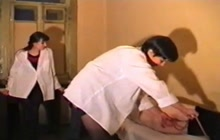 2 nurses giving enema to a dirty patient