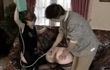 Fat mature woman getting enema