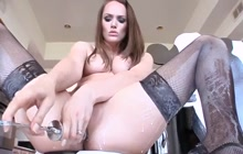 Sexy brunette squirting milk from her ass