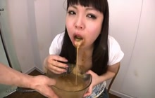 Japanese bitch drinks anal enema