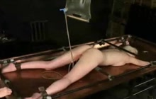 Dirty blonde in bondage gets enema