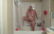 BBW doing enema in the bathroom